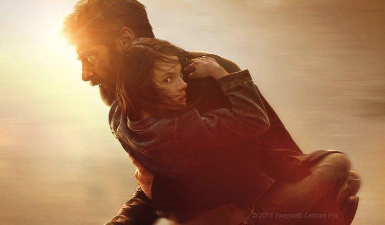 Logan hält ein Mädchen beschützend auf dem Arm und rennt