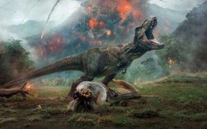 Titelbild für Kritik Jurassic Park Das gefallene Königreich mit T-Rex vor einem ausbrechenden Vulkan