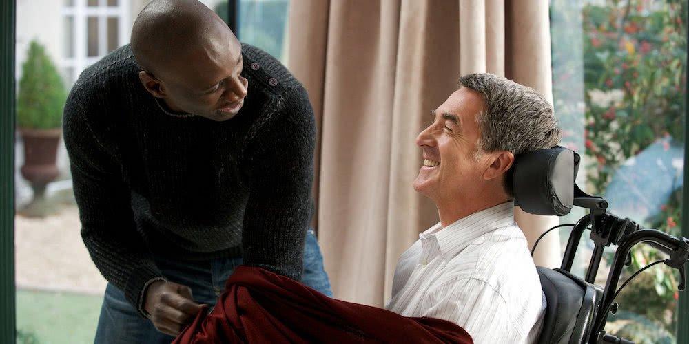 Omar Sy und François Cluzet in einem Szenenbild aus Ziemlich Beste Freunde