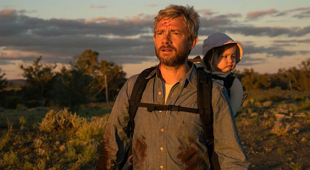 Martin Freeman mit Baby auf dem Rücken  in Cargo