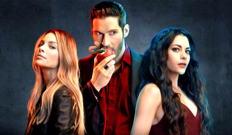 Lucifer (Tom Ellis), Chloe Decker (Lauren German) und Eva (Inbar Lavi) vor einem dunkeln Hintergrund.