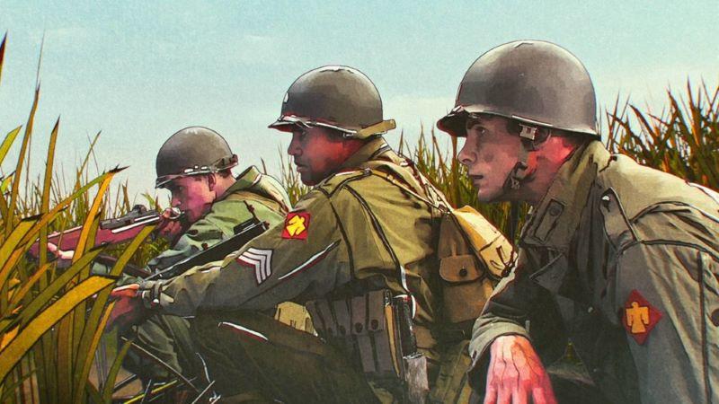 Soldaten verstecken sich in Gras in einem Szenenbild für Kritik Der Befreier von Netflix