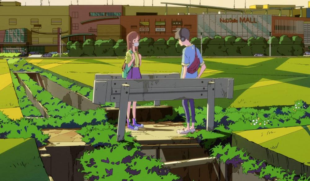Smile und Cherry stehen auf einer Brücke in einem Feld.